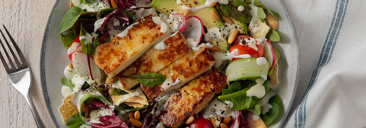 Charred Halloumi Salad with Fresh Vegetables and Lemon-Mint Yogurt Dressing