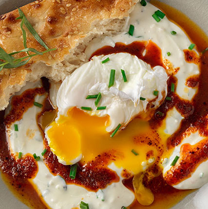 Poached Eggs on Spiced Yogurt with Aleppo Chili Drizzle and Barbari Bread